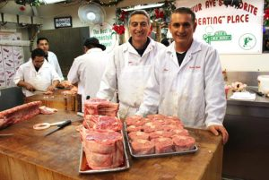 Michael Rella with Uncle Peter Servedio at their butcher shop, Peter's Meat Market, in the Arthur Avenue Market in the Bronx